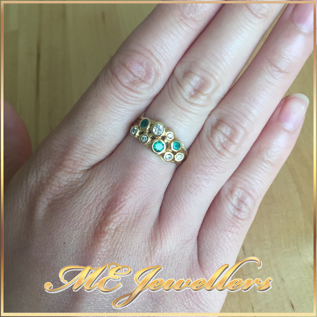 952 Emerald and Diamond Dress Ring In 18K YG on finger