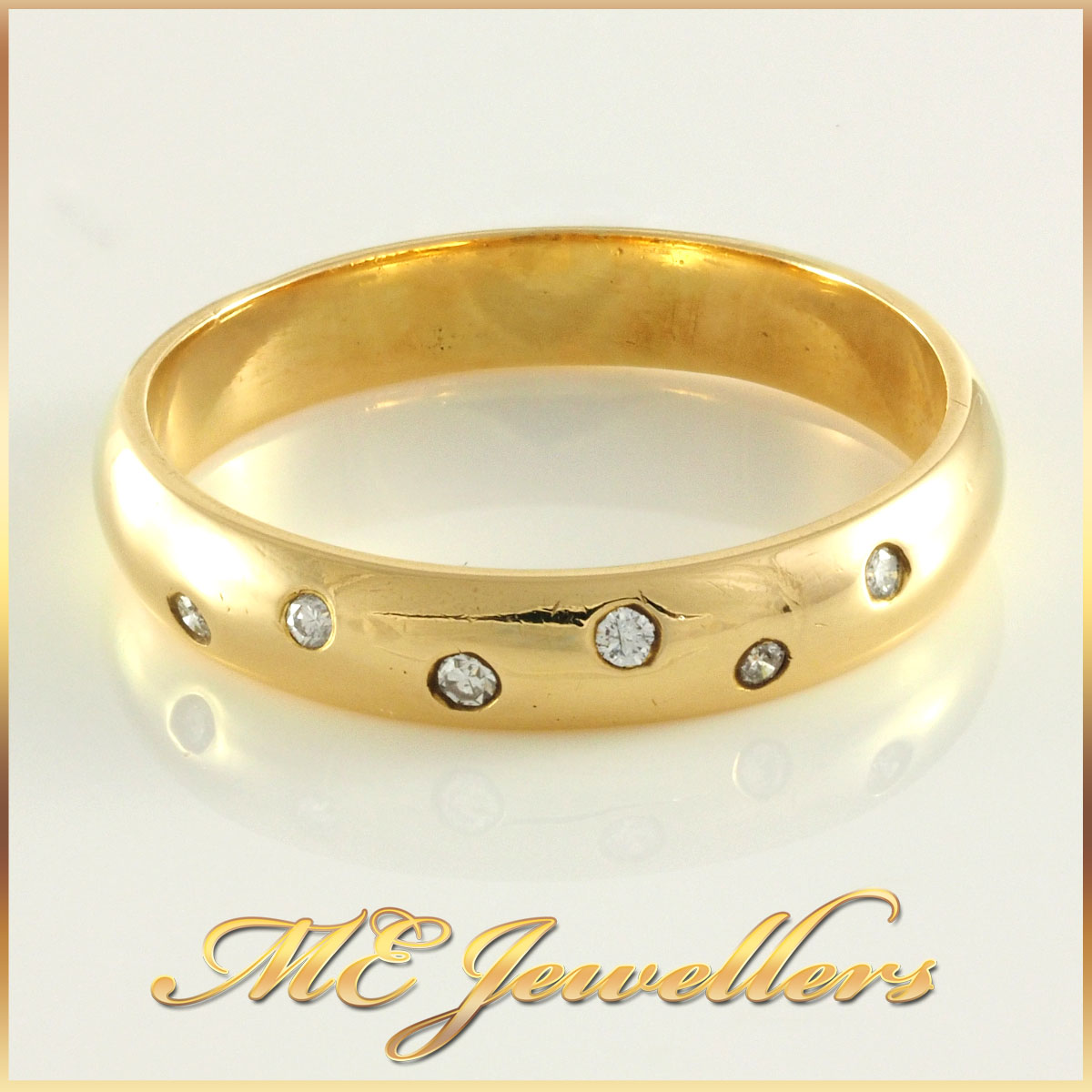 Ladies Curved Yellow Gold Diamond Band