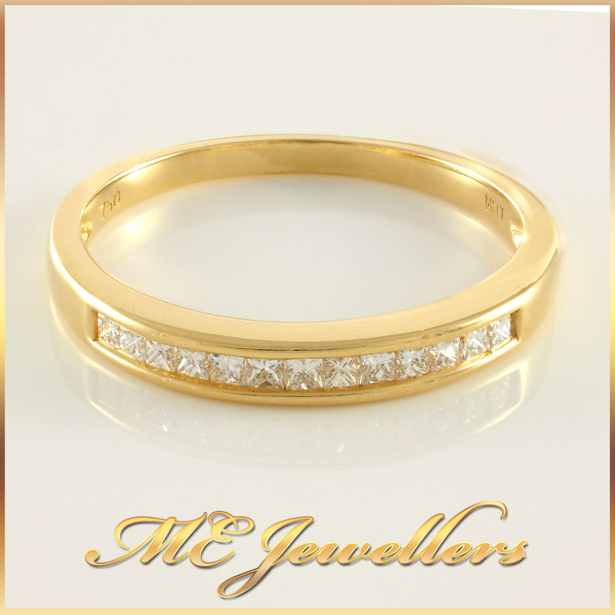 Ladies Channel Set Gold Diamond Band
