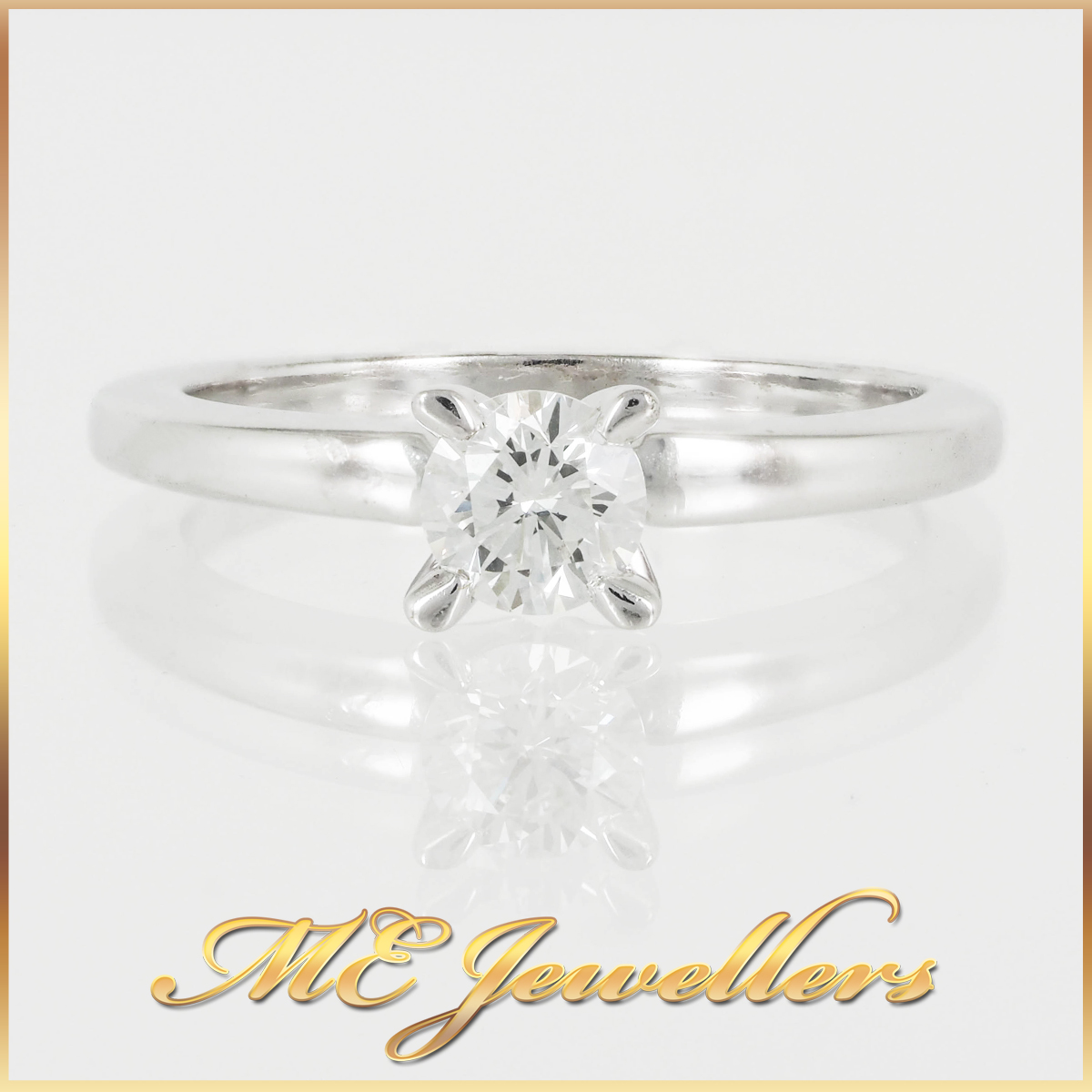 Four Prong 18k White Gold Solitaire Ring