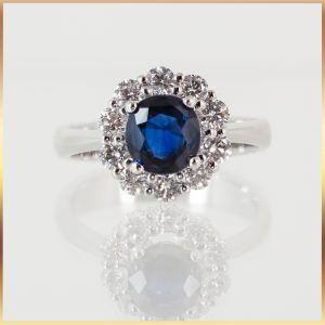 Just like a princess!  This round sapphire & diamond halo ring has such beautiful elegance. Set in 9k white gold, the 1.5ct blue sapphire is surrounded by a halo of 10 round brilliant cut diamonds. You could get lost in its depths every time you look at it.